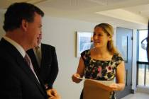 A Foreign Service Officer meets with and presents Minister Baird with an official letter regarding PAFSO's position.